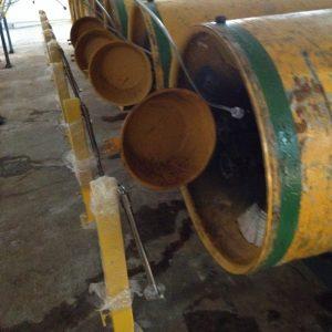 Auto shut-off arm for chlorine drum
