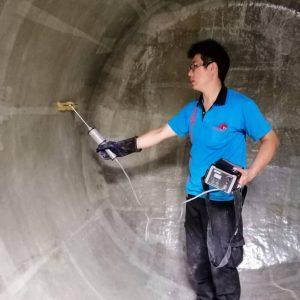 Performing spark test after fiber lamination on tanker